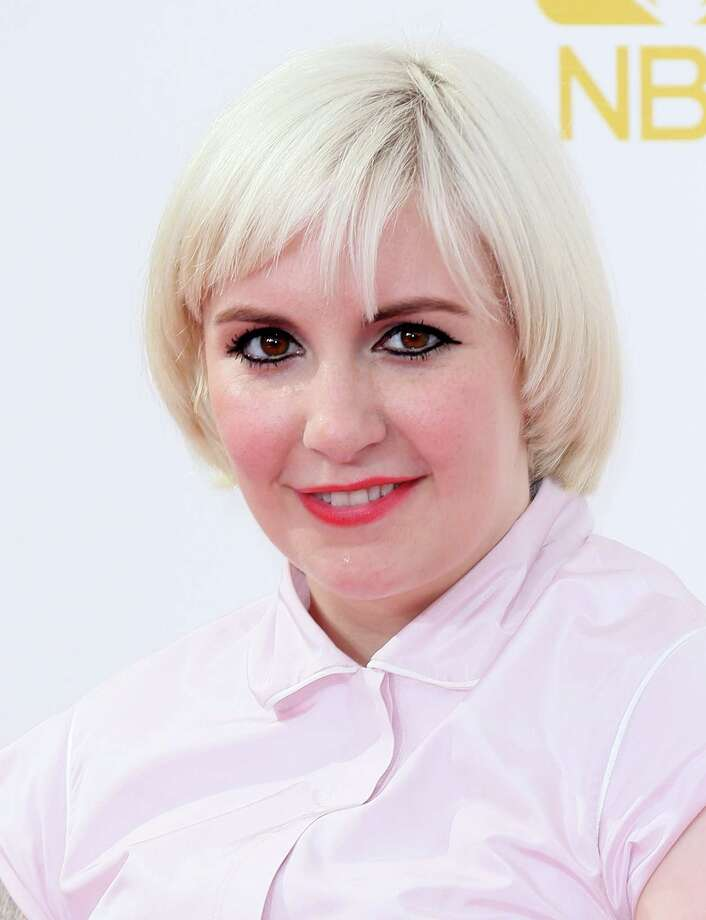 Lena Dunham's platinum blond hair walked the red carpet for the first time on Monday, during the Primetime Emmys. Fans had questioned whether the cut was a wig earlier this month, but she assured them it is not.  Photo: David Livingston, Getty Images / 2014 David Livingston
