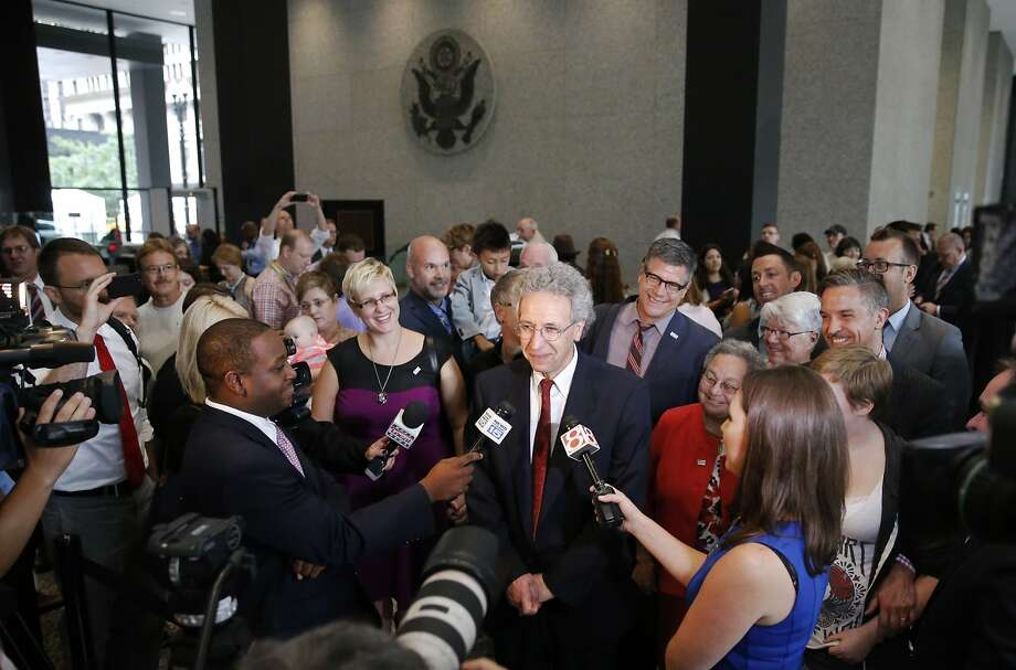 ACLU attorney Ken Faulk talks to reporters surrounded by plaintiffs and supporters of same-sex marriage after the Court of Appeals hearing in Chicago. Photo: Charles Rex Arbogast, Associated Press