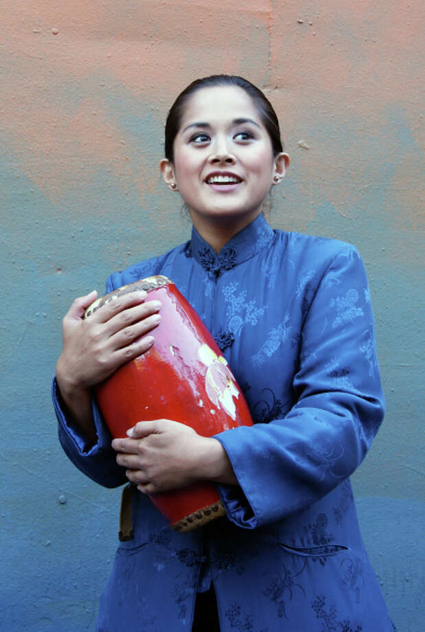 "Chinese refugee Mei Li (Catherine Gloria) is trying to start a new life in Chinatown in Woodminster Summer Musicals' ""Flower Drum Song"" at Woodminster Amphitheatre in Oakland. Photo: Kathy Kahn / Kathy Kahn / ONLINE_YES"