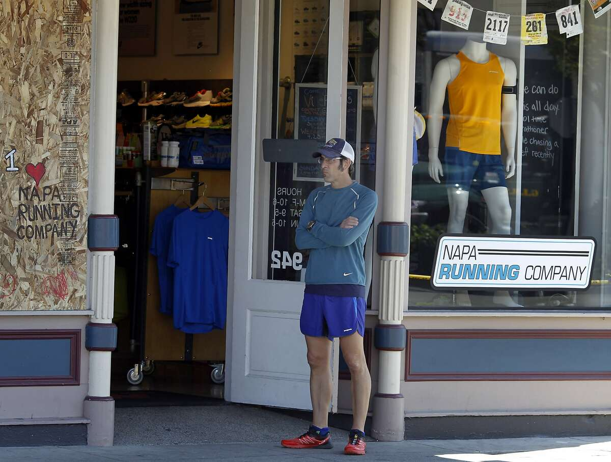 Louis Secreto waited for customers for his running shoe company on Main Street Tuesday August 26, 2014. Cleanup continued in downtown Napa, Calif. following the large earthquake early Sunday morning.