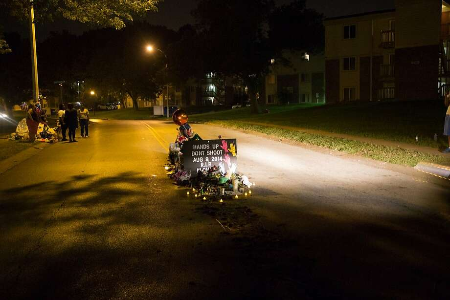 A shrine in a Ferguson, Mo., street honors Michael Brown. Photo: Brett Myers, Youth Radio