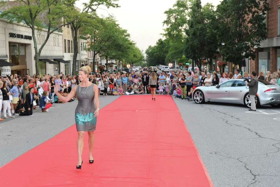 Liz Tommasino of Greenwich models an outfit during the Fashion's Night Out event on Greenwich Avenue, Thursday, Sept. 6, 2012. The annual event returns to the avenue on Friday, Sept. 5, 2014. Photo: Bob Luckey / Greenwich Time