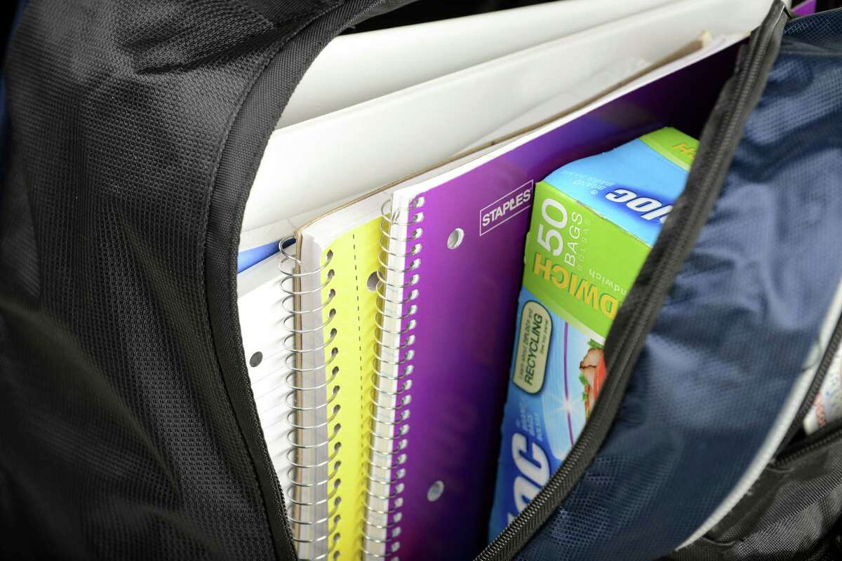 Backpack filled with school items Friday, Aug. 22, 2014, at the Times Union in Colonie, N.Y. (Will Waldron/Times Union)