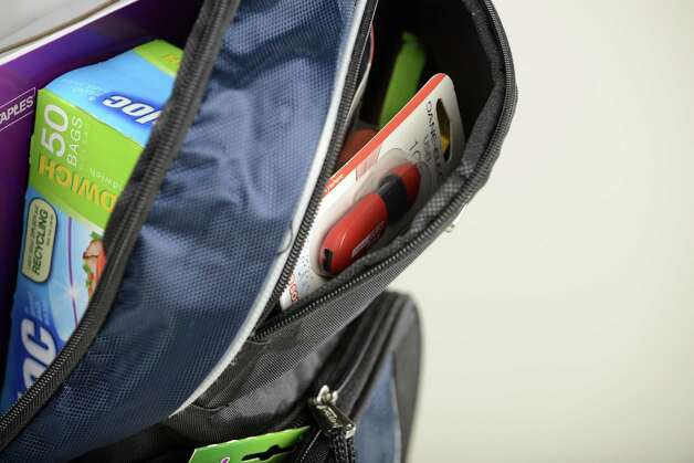 Backpack filled with school items Friday, Aug. 22, 2014, at the Times Union in Colonie, N.Y. (Will Waldron/Times Union) Photo: WW