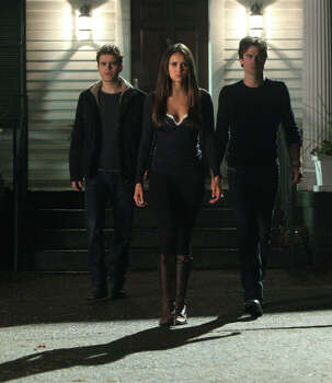 'The Vampire Diaries' - Trapped in adolescent bodies, feuding vampire brothers Stefan and Damon vie for the affection of captivating teenager Elena, who attempts to unravel the many dark secrets of her hometown of Mystic Falls. Available Oct. 2 Photo: Annette Brown, The CW / ©2013 The CW Network. All Rights Reserved.