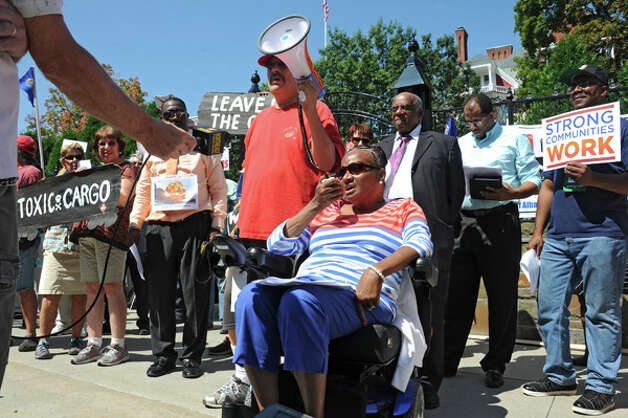 Charlene Benton, president of Ezra Prentice Tenant Association, speaks using a megaphone as oil train opponents rally in front of the Governor's Mansion on Tuesday, Aug. 26, 2014 in Albany, N.Y.  (Lori Van Buren / Times Union) Photo: Lori Van Buren, Albany Times Union / 00028281A