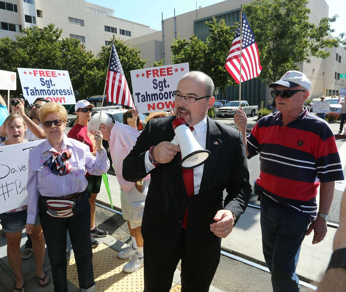 Assemblyman Tim Donnelly, R-Twin Peaks, calls for the release of Marine Andrew Tahmooressi, who was detained by the Mexican government for crossing the border with weapons, during a rally outside the Stanford Mansion where Mexican President Enrique Pena Nieto will appear with Gov. Jerry Brown, in Sacramento, Calif., Tuesday, Aug. 26, 2014.(AP Photo/Rich Pedroncelli)