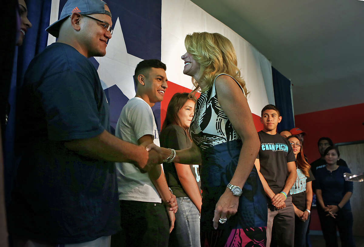 Democrat candidate for Governor of Texas, Senator Wendy Davis, right, greets students after addressing the media outlining her ideas for higher education, during a press conference at Palo Alto College. Tuesday, Aug. 26, 2014.