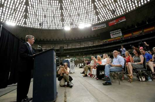 Harris County Judge Ed Emmett makes his suggestion to turn the Astrodome into the world's largest indoor park during a press conference at the historic domed stadium Tuesday, Aug. 26, 2014, in Houston. Emmett said his idea would include spaces for festivals and other gatherings, as well as hiking, biking and fitness trails on the stadium's upper levels. He had no cost estimate or firm plan for its funding, though he suggested creating private-public partnerships to pay for it. (AP Photo/Pat Sullivan) Photo: Pat Sullivan, Associated Press / AP