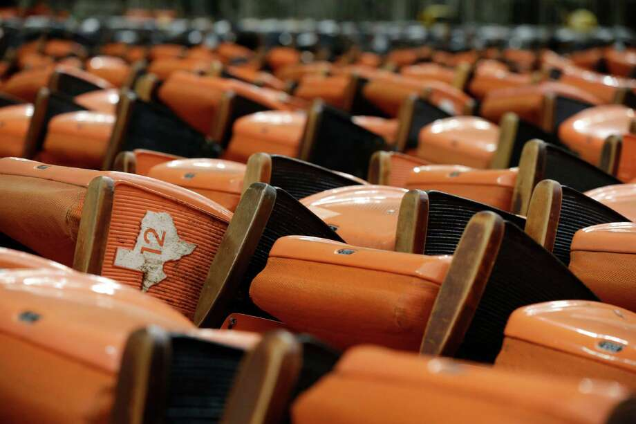 "Old Astrodome stadium seats sit in stacks around the unused historic domed stadium Tuesday, Aug. 26, 2014, in Houston. County officials are proposing turning the ""Eighth Wonder of the World"" into the world's largest indoor park. (AP Photo/Pat Sullivan) Photo: Pat Sullivan, Associated Press / AP"