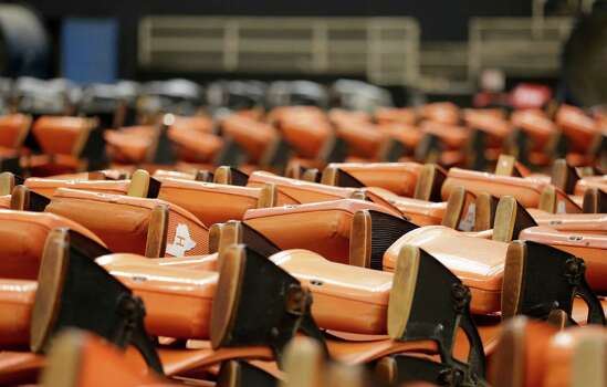 Old Astrodome stadium seats sit in stacks around the unused historic domed stadium Tuesday, Aug. 26, 2014, in Houston. County officials are proposing turning the stadium into the world's largest indoor park. (AP Photo/Pat Sullivan) Photo: Pat Sullivan, Associated Press / AP