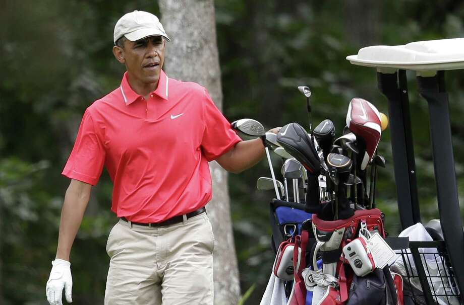President Barack Obama's juxtaposition of his tee time and a beheading is disturbing. Photo: Steven Senne / Associated Press / AP