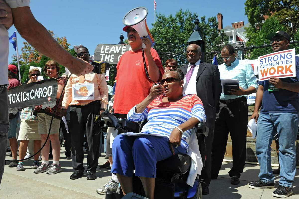 Charlene Benton, president of Ezra Prentice Tenant Association, speaks using a megaphone as oil train opponents rally in front of the Governor's Mansion on Tuesday, Aug. 26, 2014 in Albany, N.Y. (Lori Van Buren / Times Union)