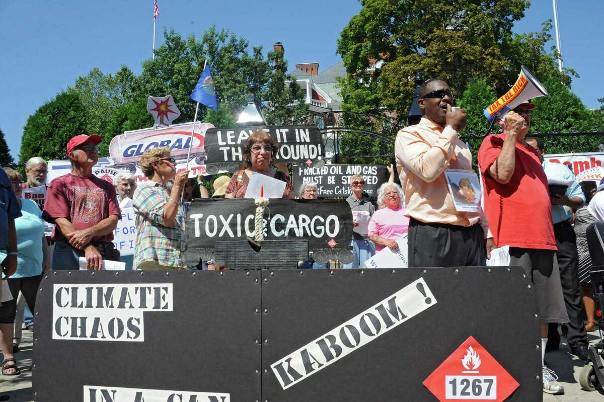 Willie White, Executive Director of AVillage, speaks using a megaphone as oil train opponents rally in front of the Governor's Mansion on Tuesday, Aug. 26, 2014 in Albany, N.Y. (Lori Van Buren / Times Union)