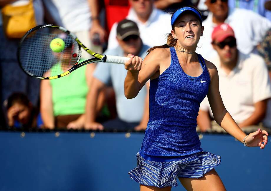 "Catherine ""CiCi"" Bellis returns a shot against 12th-seeded Dominika Cibulkova, whom she defeated 6-1, 4-6, 6-4 in their first-round match at the U.S. Open. Photo: Streeter Lecka, Getty Images"