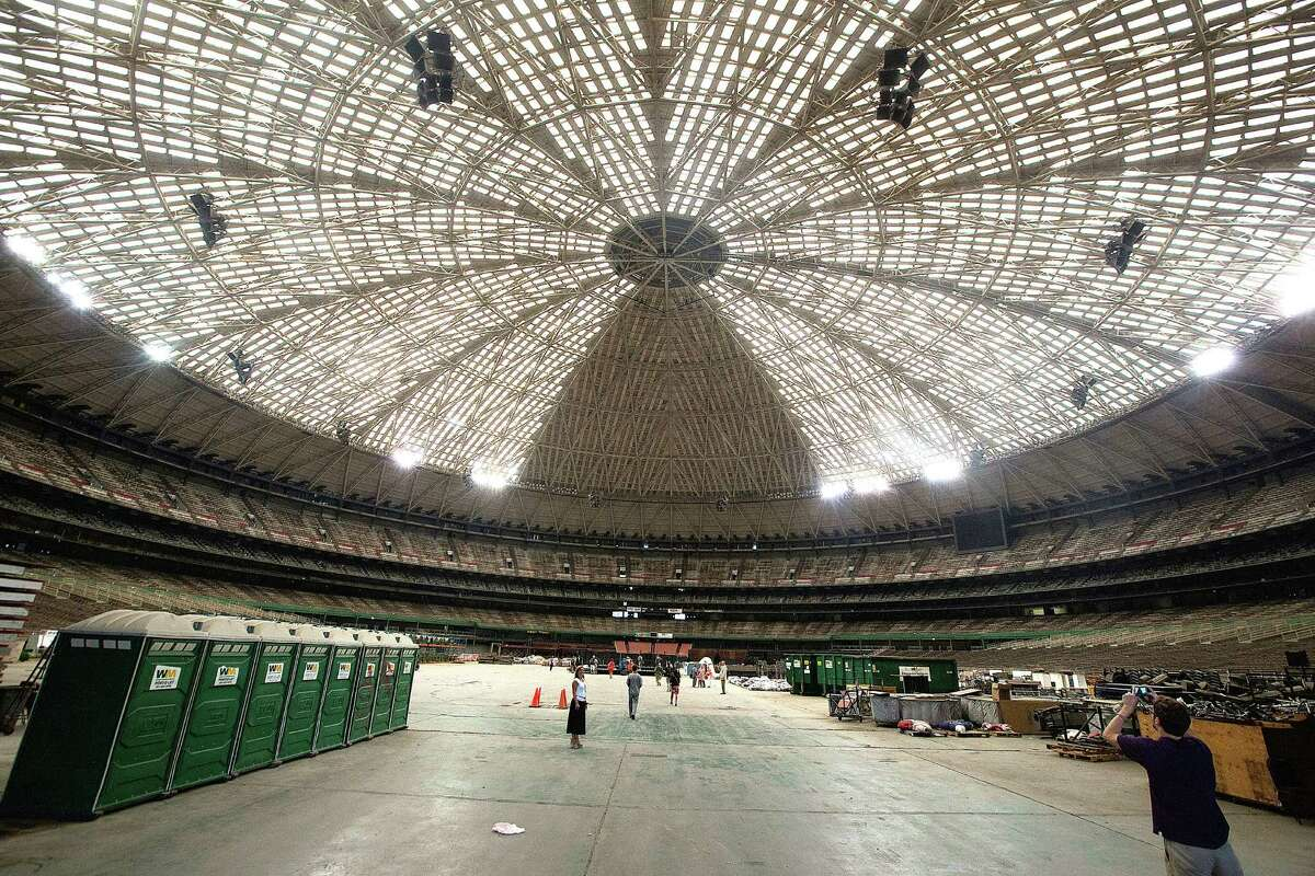 Members of the media begin to walk into the Astrodome before Harris County Harris County Judge Ed Emmett unveiled his plan for the Astrodome, to make it