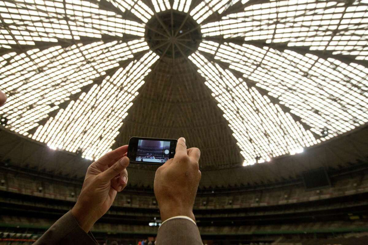 David Ellison, media information officer for Harris County Commissioner El Franco Lee, takes a video of the Astrodome before Harris County Harris County Judge Ed Emmett unveiled his plan for the Astrodome, to make it