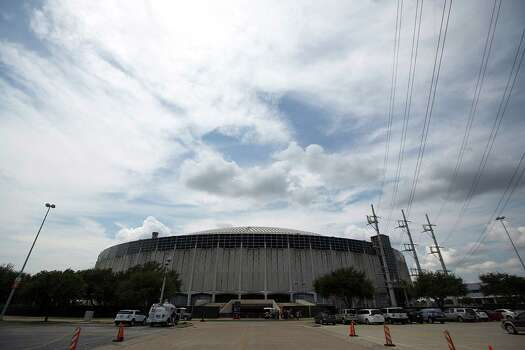 "The Astrodome before Harris County Harris County Judge Ed Emmett unveiled his plan for the Astrodome, to make it ""the worlds largest indoor park,"" during a press conference on the floor of the Astrodome Tuesday, Aug. 26, 2014, in Houston. Emmett said he envisions a large park area, with running and hiking trails, pavilion, spaces for education and events. Photo: Johnny Hanson, Houston Chronicle / © 2014  Houston Chronicle"