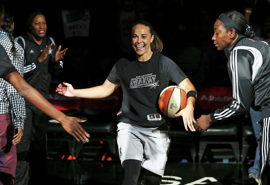 San Antonio Stars' Becky Hammon is introduced as the Stars play the Minnesota Lynx in a WNBA basketball game on Aug. 15 in San Antonio. She has been hired as an assistant coach by NBA champion San Antonio Spurs. Photo: Tom Reel, MBO / The San Antonio Express-News