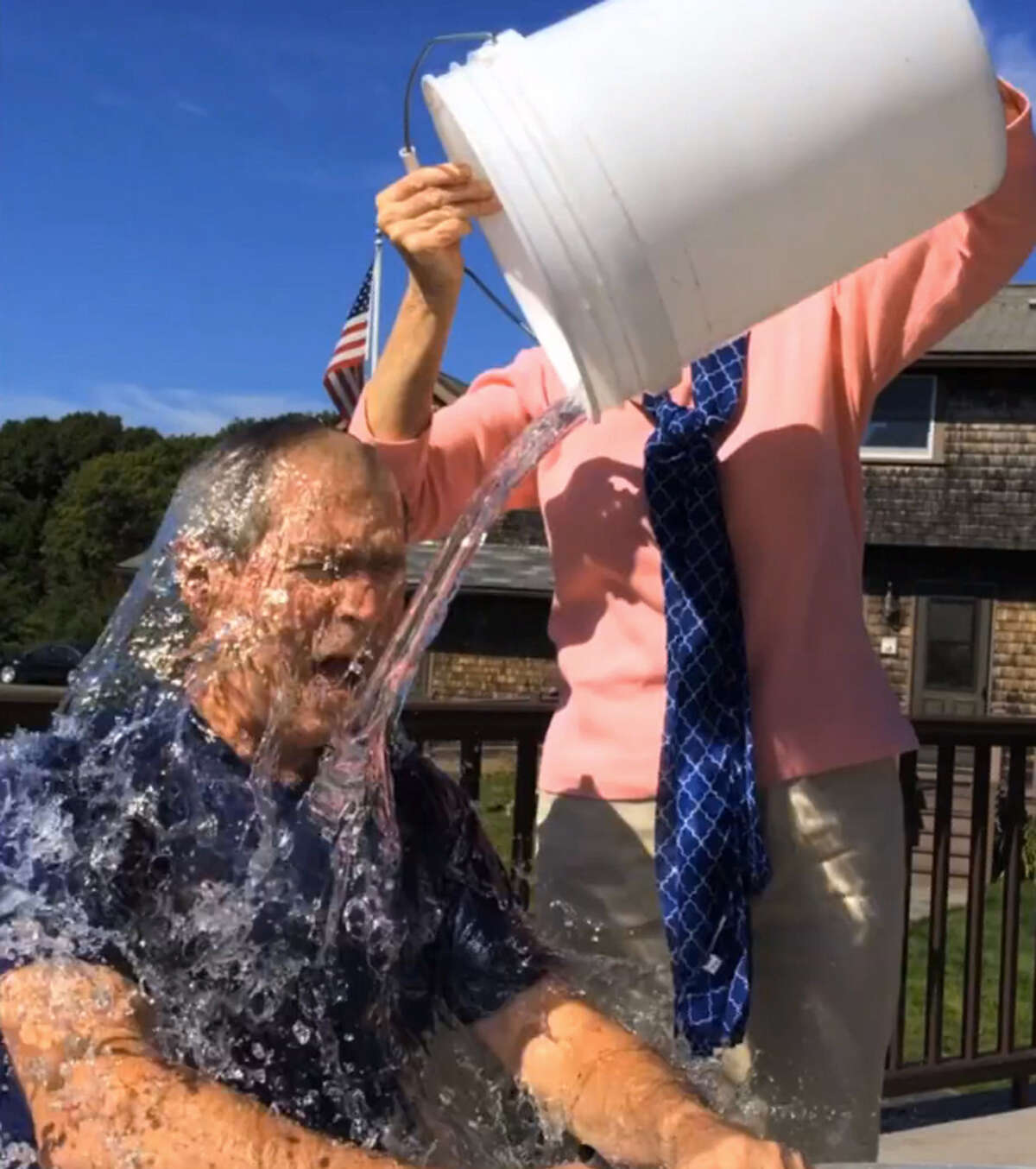 Former President George W. Bush participates in the ALS Ice Bucket Challenge with the help of his wife, Laura, in Kennebunkport, Maine.