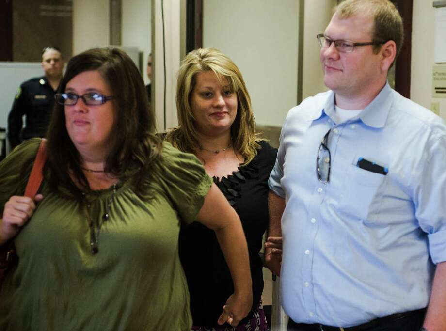 April Bertrand, mother of Alexandria Bertrand, center, holds hands with family members as they leave the 163rd District Courtroom on Tuesday afternoon. The trial of Kelvin Lee Roy, the driver in a February wreck that took the life of 16-year-old Alexandria Nicole Bertrand, continued in the 163rd District Court at the Orange County Courthouse on Tuesday afternoon. Photo taken Tuesday 8/26/14 Jake Daniels/@JakeD_in_SETX Photo: Jake Daniels / ©2014 The Beaumont Enterprise/Jake Daniels