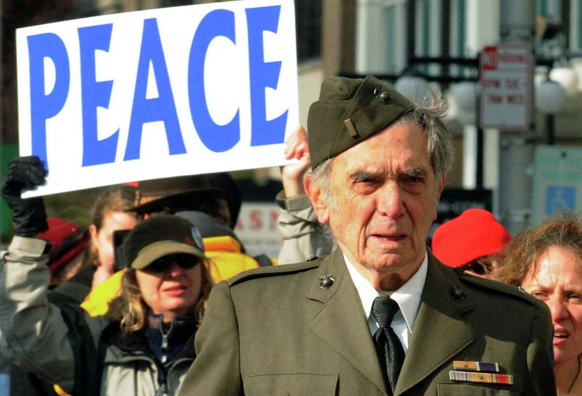 World War II veteran Ed Bloch of Albany walks with Veterans for Peace and Occupy Albany participants in the Veterans Day Parade in Albany, NY Friday, Nov.11, 2011. ( Michael P. Farrell/Times Union archive)