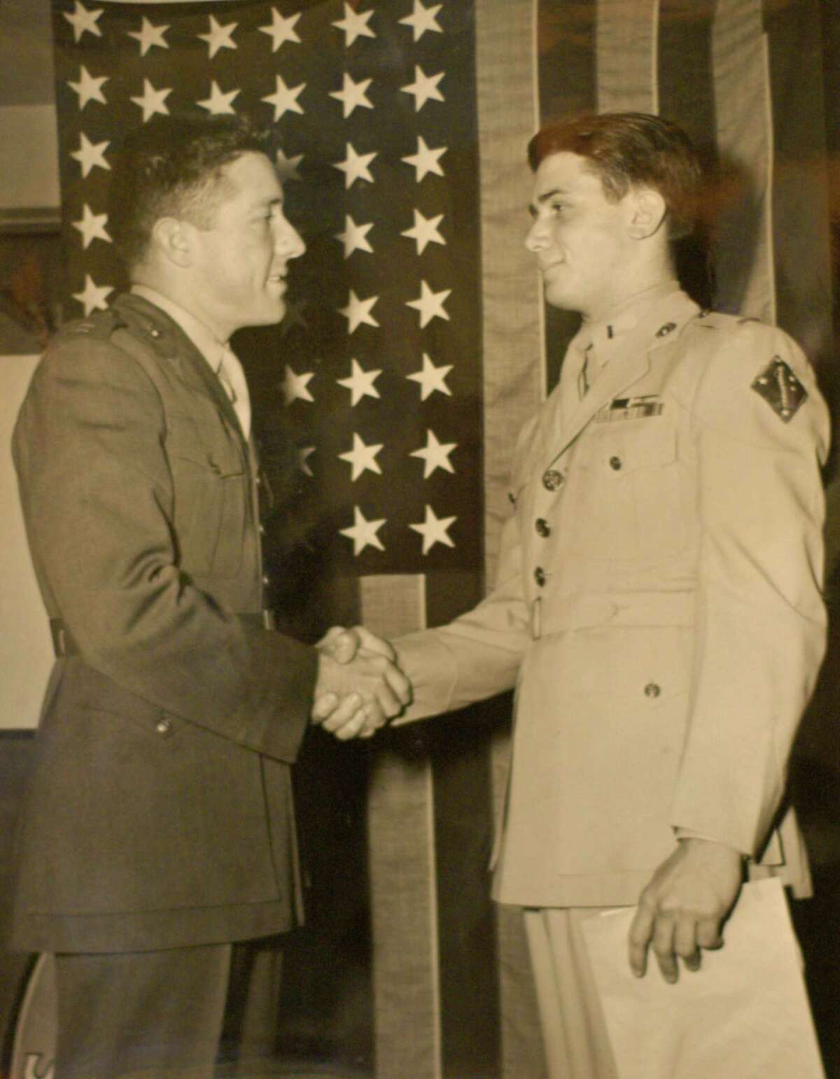 Ed Bloch, of Latham, N.Y., right, in a 1946 photo when he received his Bronze Star. (Provided photo/Times Union archive)