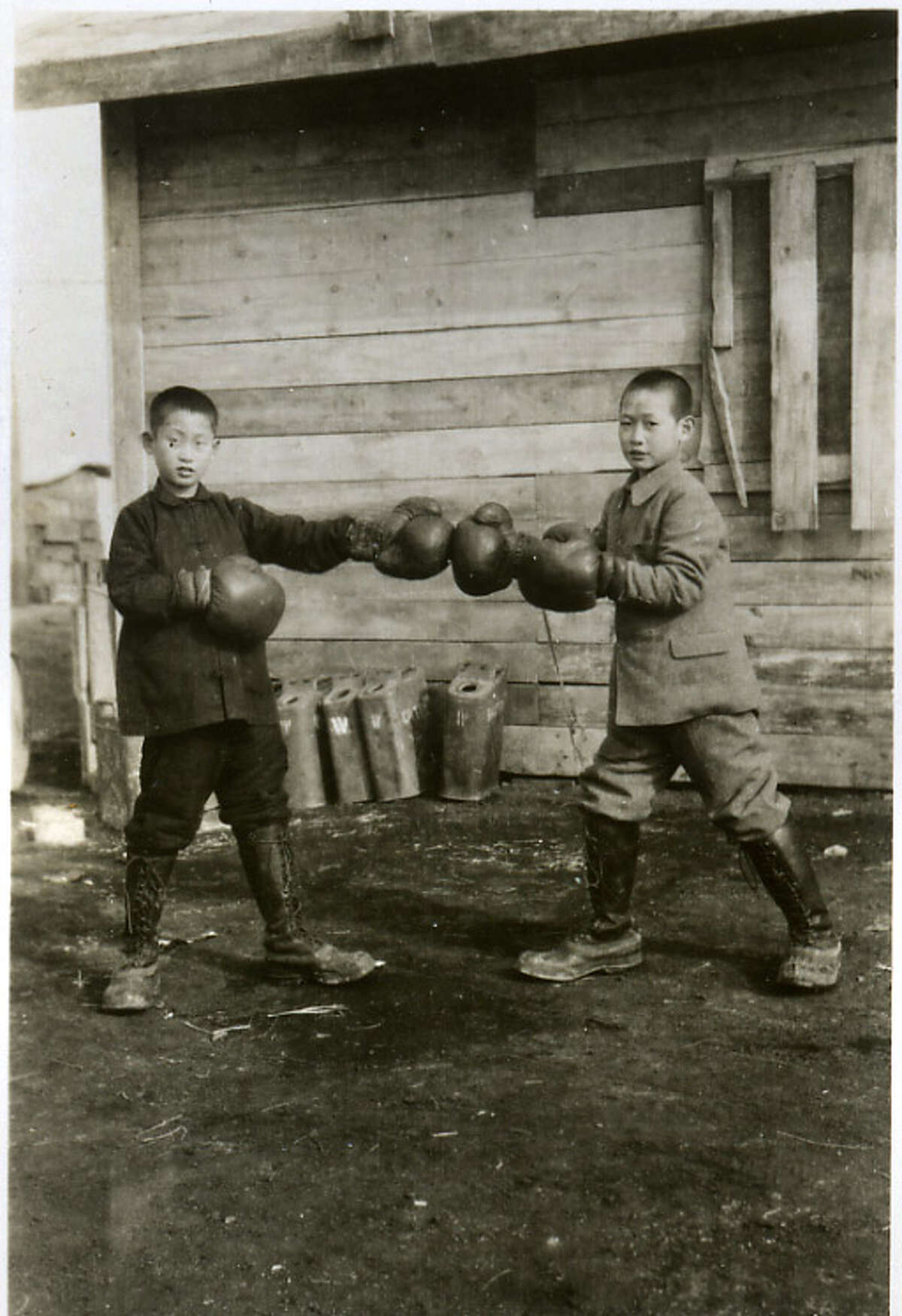 Chinese boys practice boxing with gloves and lessons given to them by U.S. Marines in the fall of 1945. Ed Bloch of Latham gave the order to open fire and destroy a mud-hut village near Han Ku. (Photo courtesy of Ed Bloch/Times Union archive)
