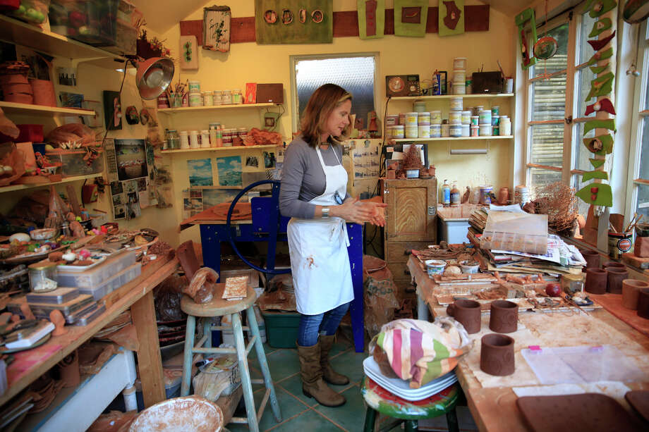 San Francisco ceramicist Lisa Neimeth works on tableware in her studio using collections of found and vintage objects to create impressions in clay. Photo: Lea Suzuki / Lea Suzuki / The Chronicle / ONLINE_YES