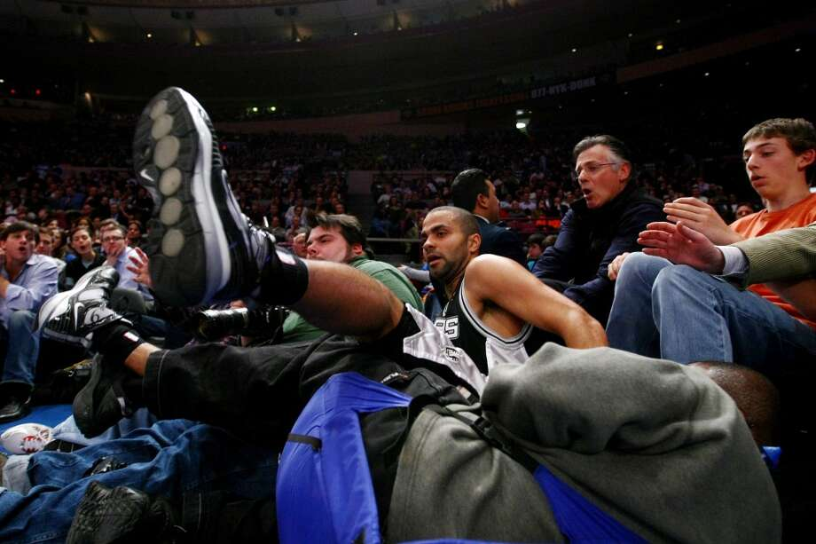 The Spurs' Tony Parker crashes into photographers and the crowd against the New York Knicks at Madison Square Garden Feb. 17, 2009, in New York City. Photo: Chris McGrath, Getty Images