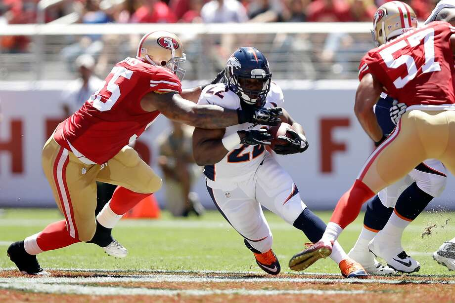 SANTA CLARA, CA - AUGUST 17:  Running back C.J. Anderson #22 of the Denver Broncos runs past outside linebacker Ahmad Brooks #55 of the San Francisco 49ers during a preseason game at Levi's Stadium on August 17, 2014 in Santa Clara, California.  (Photo by Ezra Shaw/Getty Images) Photo: Ezra Shaw, Getty Images