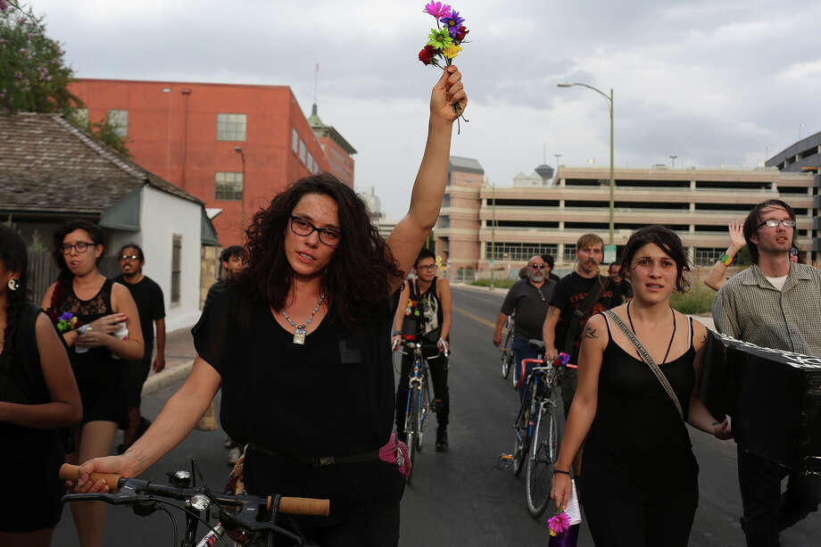 "Jenny Allen, left, walks with demonstrators from San Fernando Cathedral to Public Safety Headquarters during ""Eulogy for the Forgotten: A Response to Local and National Police Brutality"" in San Antonio on Tuesday, August 26, 2014. Photo: Lisa Krantz / SAN ANTONIO EXPRESS-NEWS"