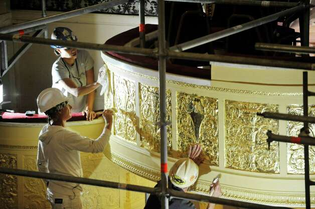 Workers apply gold leaf as the restoration and re-painting of the inside of Proctors continues on Tuesday, Aug. 26, 2014, in Schenectady, N.Y.  (Paul Buckowski / Times Union) Photo: Paul Buckowski / 00028294A