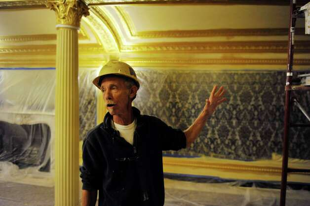 Jed Ellis, site superintendent with Evergreene Architectural Arts, talks about the work being done as part of the restoration and re-painting of the inside of Proctors continues on Tuesday, Aug. 26, 2014, in Schenectady, N.Y.  (Paul Buckowski / Times Union) Photo: Paul Buckowski / 00028294A