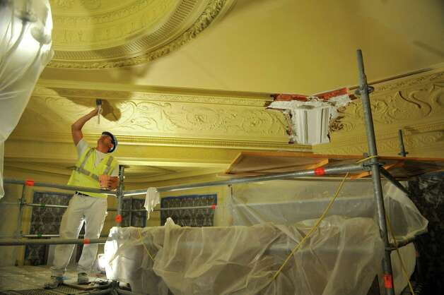 Mike Crimaldi, a plasterer with Evergreene Architectural Arts, works on the ceiling as the restoration and re-painting of the inside of Proctors continues on Tuesday, Aug. 26, 2014, in Schenectady, N.Y.  (Paul Buckowski / Times Union) Photo: Paul Buckowski / 00028294A