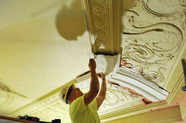 Mike Aragosa, plaster superintendent with Evergreene Architectural Arts, fits a plaster piece made from a mold inside the ceiling as the restoration and re-painting of the inside of Proctors continues on Tuesday, Aug. 26, 2014, in Schenectady, N.Y.  (Paul Buckowski / Times Union) Photo: Paul Buckowski / 00028294A
