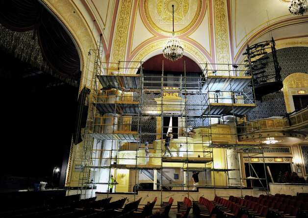 Workers use scaffolding as the restoration and re-painting of the inside of Proctors continues on Tuesday, Aug. 26, 2014, in Schenectady, N.Y.  (Paul Buckowski / Times Union) Photo: Paul Buckowski / 00028294A