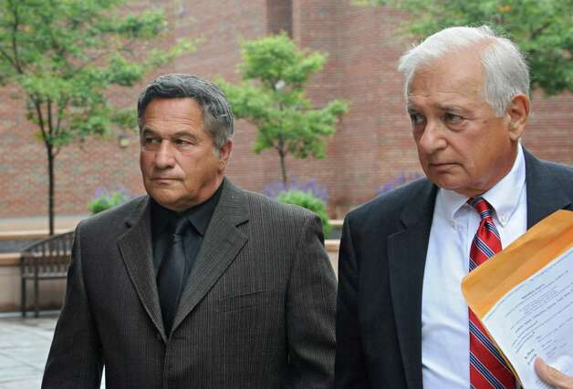 Bruce Tanski, left, leaves the Saratoga County Courthouse with his attorney William Dreyer after he was arraigned on  an eight-count indictment that accuses him of offering a false instrument and seven election law violations on Friday, Aug. 22, 2014 in Ballston Spa, N.Y. Tanski, a prominent Halfmoon builder, was arrested by State Police on charges alleging he paid employees and business associates to make political contributions to the campaign account of Melinda Wormuth, a former Halfmoon town supervisor. (Lori Van Buren / Times Union) Photo: Lori Van Buren / 00028289A