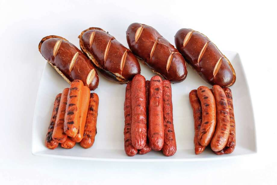 Uncured hotdogs from Llano Seco, Prather Ranch Meat Co. and 4505 Meats with Pretzilla buns — a pretzel-meets-bun hybrid Photo: Russell Yip / Russell Yip / Russell Yip / The Chronicle / ONLINE_YES