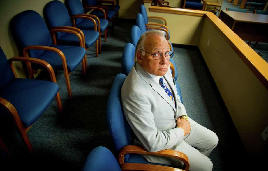 """Attorney Rick Brass,  in the jury  box at the 9th District Court in  Conroe, says prosecutors are fighting him because they're worried """"what I might find."""" Photo: Billy Smith II, Staff / © 2014 Houston Chronicle"""