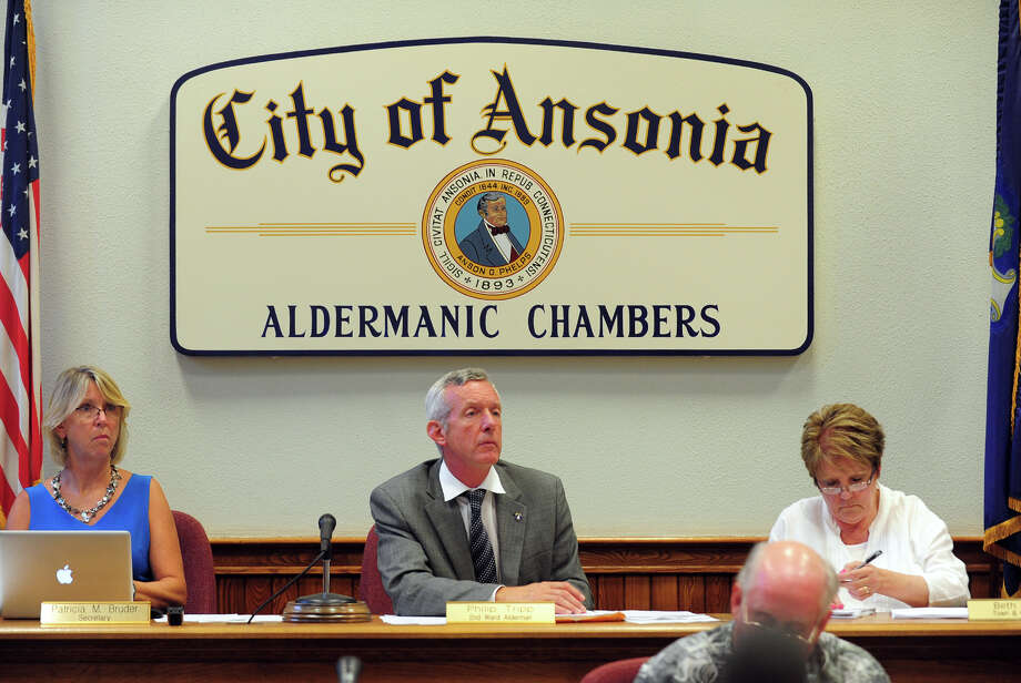Second Ward Alderman Philip Tripp heads a Board of Alderman meeting held at Ansonia City Hall in Ansonia, Conn. on Tuesday August 26, 2014. One of the items on the agenda is to consider Charter Revision changes to reduce the number of wards from 7 to 3 and to reduce the number of aldermen from 14 to 9. Photo: Christian Abraham / Connecticut Post