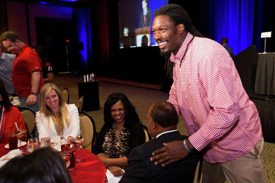 In keeping with the light-hearted mood at the Texans' annual luncheon Tuesday at the Hilton Americas, rookie linebacker Jadeveon Clowney entertains those sitting at his table. Photo: Brett Coomer, Staff / © 2014  Houston Chronicle
