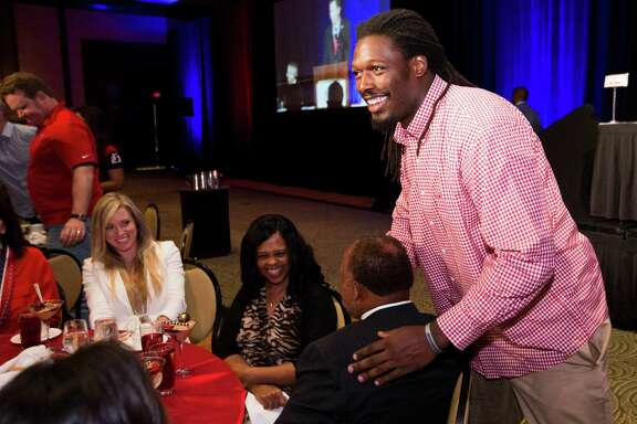 In keeping with the light-hearted mood at the Texans' annual luncheon Tuesday at the Hilton Americas, rookie linebacker Jadeveon Clowney entertains those sitting at his table.
