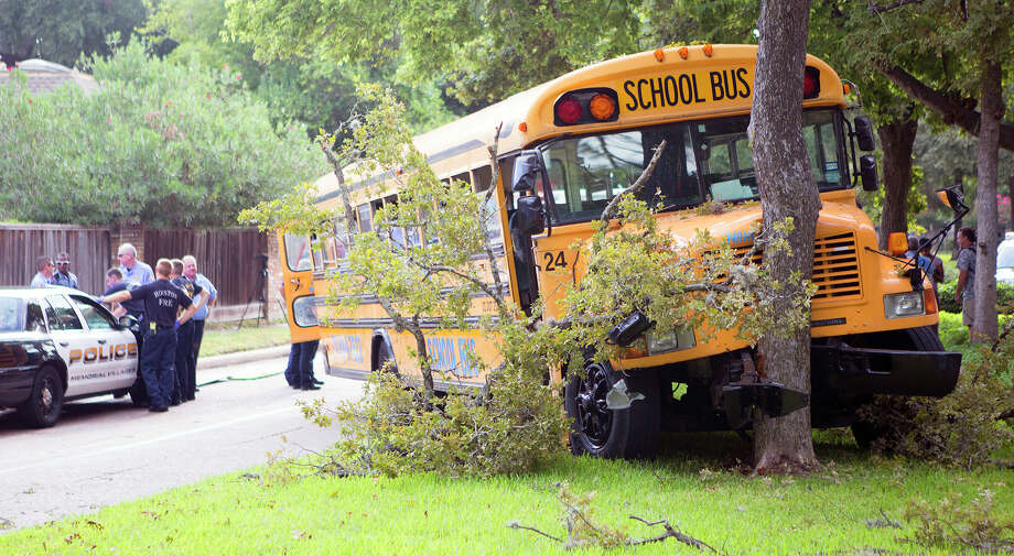 A school bus veered into a tree Tuesday as it was taking 22 students to HISD's Revere Middle School. The driver, taken to the hospital, told police a mechanical failure was to blame. The bus company owner could not be reached for comment. Photo: Cody Duty, Staff / © 2014 Houston Chronicle