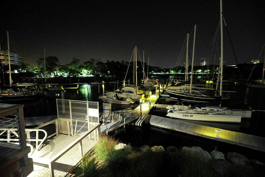 Emergency crews responded to Yacht Haven on Harbor Drive in Stamford, Conn., for a man that was injured by a propeller while wake boarding in Long Island Sound on Tuesday, Aug. 26, 2014. Police are investigating the incident. Photo: Jason Rearick / Stamford Advocate