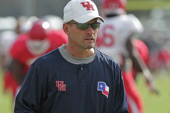 University of Houston defensive coordinator David Gibbs works with defensive players at practice Tuesday, Oct. 15, 2013, in Houston.   ( James Nielsen / Houston Chronicle )