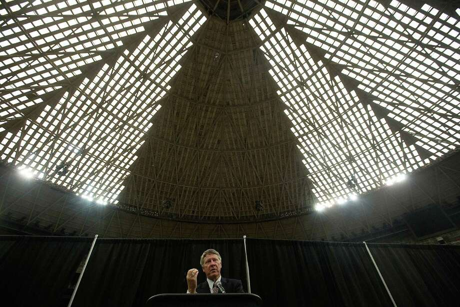 "Harris County Judge Ed Emmett unveils his concept for the Astrodome, to make it ""the world's largest indoor park,"" during a recent news conference on the floor of the storied sports stadium. Photo: Johnny Hanson, Staff / © 2014  Houston Chronicle"