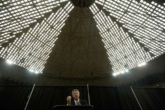 """Harris County Judge Ed Emmett unveils his concept for the Astrodome, to make it """"the world's largest indoor park,"""" during a recent news conference on the floor of the storied sports stadium."""