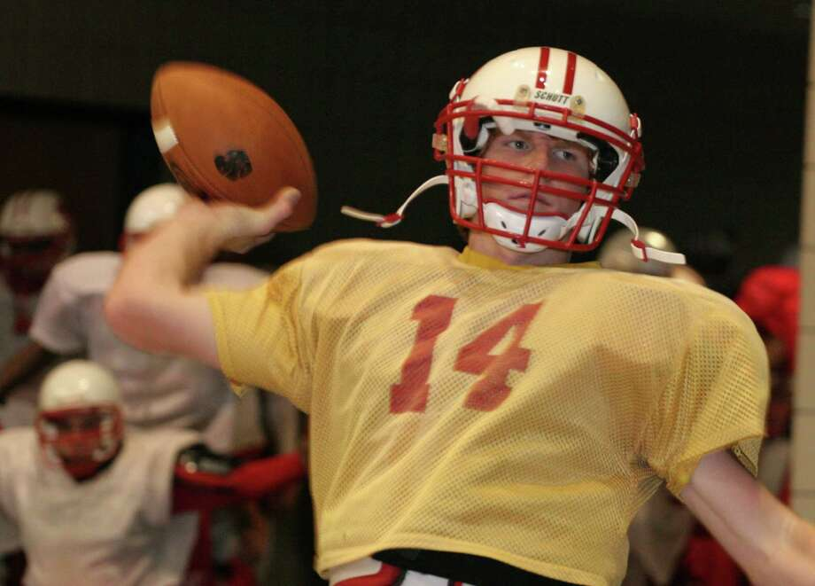 Andy Dalton, QB for Katy High School throwing a pass during practice at the Leonard E. Merrell Center in Katy.  Practice was moved inside due to weather conditions. December 7, 2005.  (For the Chronicle/Gary Fountain)   FREELANCE Photo: Gary Fountain, Freelance / Freelance