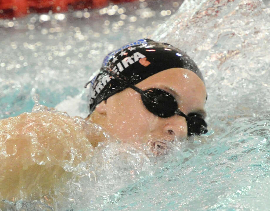 Darien's Courtney Ferreira competes in the 500 freestyle event during the FCIAC girls swimming championship at Greenwich High School on Wednesday, Oct. 30, 2013. Photo: Bob Luckey / Greenwich Time